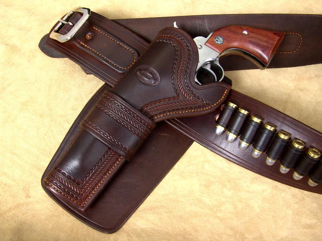 Cowboy Guns Wallpaper OK pardner  we got your guns